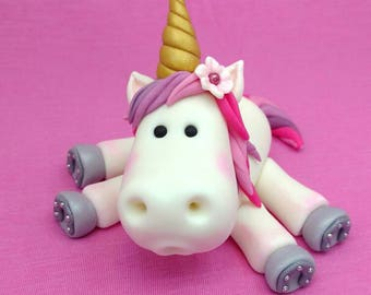 Unicorn rainbow horse pony pinks and purples with golden horn and sparkling shoes.