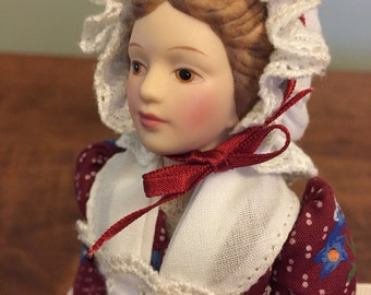 Avon porcelain doll - early American colonial girl