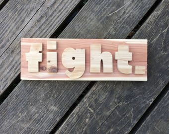 FIGHT sign made from cedar treehouse scraps
