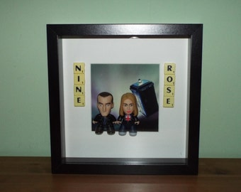 Doctor Who Ninth Doctor and Rose Tyler Titan figures with scrabble tiles in a frame