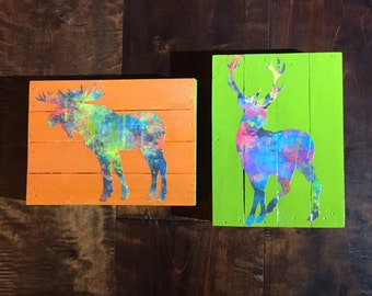 Colorful moose and deer pics decoupaged on wood green orange blue