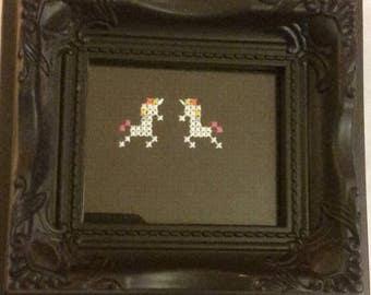 Mini framed unicorn cross stitch.