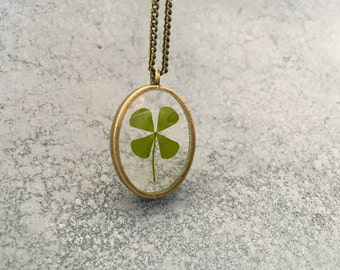 Four Leaf Clover in a dainty Oval Open-Back Antique Bronze Bezel Resin Necklace