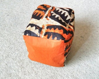 Orange Babies soft play cube with African batik