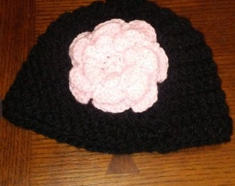 Chunky Black hat with a pink flower