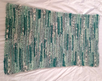 Green crochet rag rug