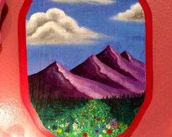 Mountain scene with field of flowers