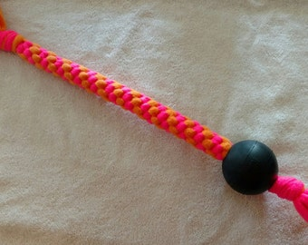 Fleece dog toy-dog tug toy-with Kong Extreme Bounce ball in neon pink and orange