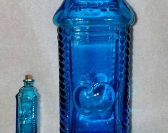Wheaton glass, Berrings Apple Bitters,  w/mini-me bottle. Clear medium blue color.