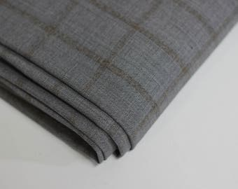 Open weave suiting fabric - grey with brown check lines