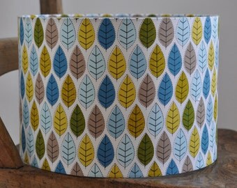 NEW: Hand rolled drum lampshade in blue, green and gold leaves fabric