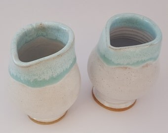 A pair of small hand thrown jugs