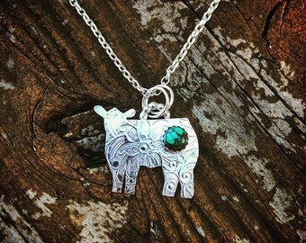 Sterling Silver textured Heifer with a genuine turquoise stone