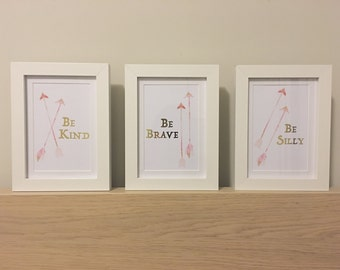 """Set of 3 small prints """"Be Kind Be Brave Be Silly"""" pink watercolour arrows and gold foil text"""
