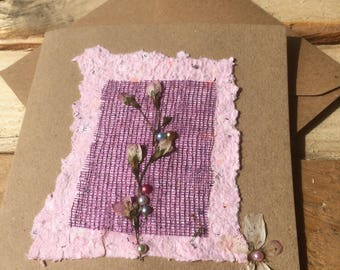 Handmade card with recycled fabrics, pearlescent beads and pressed flowers. This card is blank inside for your own personal message.