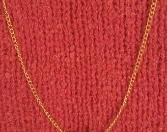 Gold tone chain with sideway cross