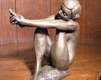 Bronze resin sculpture of a female figure