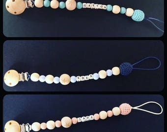 Pacifier clip made of wooden beads and silicone with name