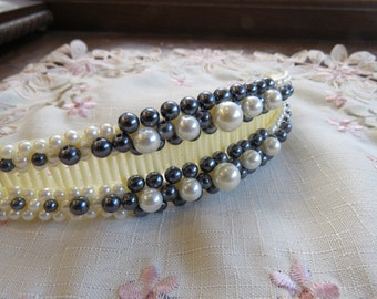 Black and white faux pearl decorated hair claw