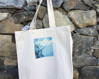 Blue snow and trees tote bag