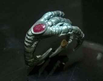 Silver ring for men and women as Crow paw with natural ruby.