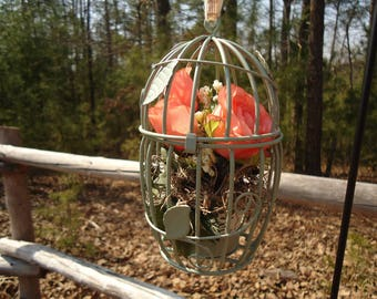 metal birdcage floral arrangement