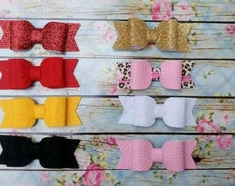 Assorted girls tuxedo bows on clips