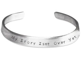 CUFF BANGLE BRACELET My Story Isn't Over Yet!! Positive Affirmation on a lovely silver cuff bracelet! Strong Woman Gift Jewelry
