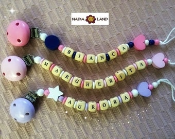 Pacifier holder with the name of the baby