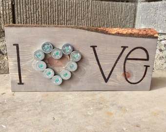 Love sign, woodburned by hand with shotgun shell heart