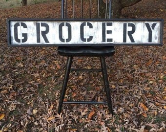 "Handcrafted distressed ""GROCERY"" sign"