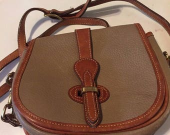 Dooney & Bourke All weather leather crossbody bag pebbled taupe and tan Handbag