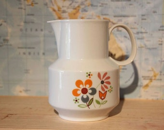 Vintage jug with a floral pattern