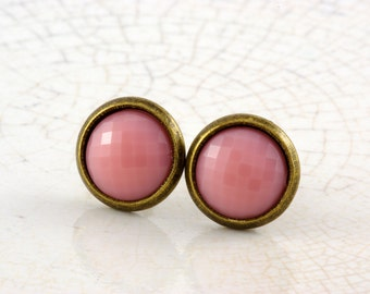 small pink sparkling studs in bronze
