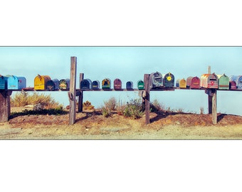 Group of colorful rural mailboxes in a row on a country road.  Size 12 x 36 or 20 x 54 inch panoramic photograph art decor living room