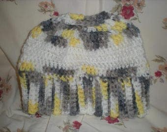 Hand crocheted messy buy/pony tail hat.