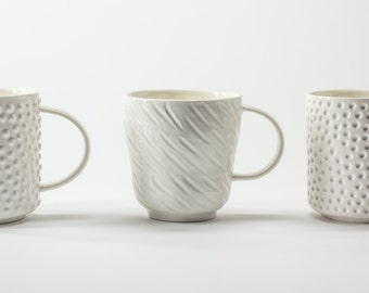 White porcelain RAIN cup. Modern handmade ceramic tea mug. Contemporary coffee cup with a stripe pattern