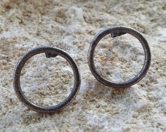 Oxidized earrings in frosted sterling silver