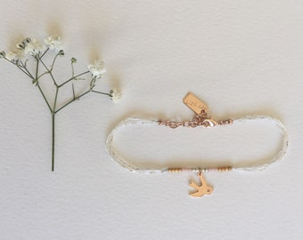 The flight, broken white glittery cord bracelet