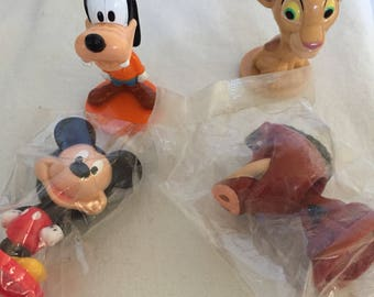 Kelloggs Cereal Disney Bobble Heads.