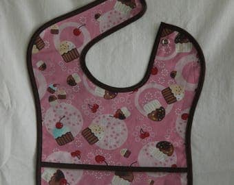 Baby to toddler waterproof, yummy cupcake print bib with pocket and snap