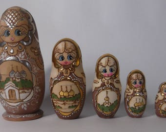 five-piece Matryoshka set painted with gold paint