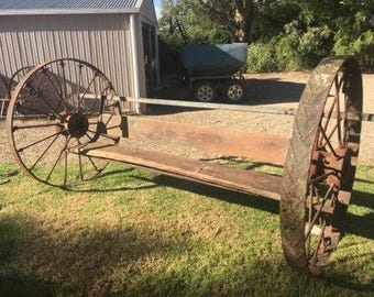 Out door chair made from wagon wheels