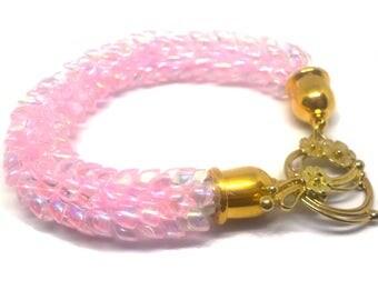 Soft pink bracelet beaded on a Kumihimo braid