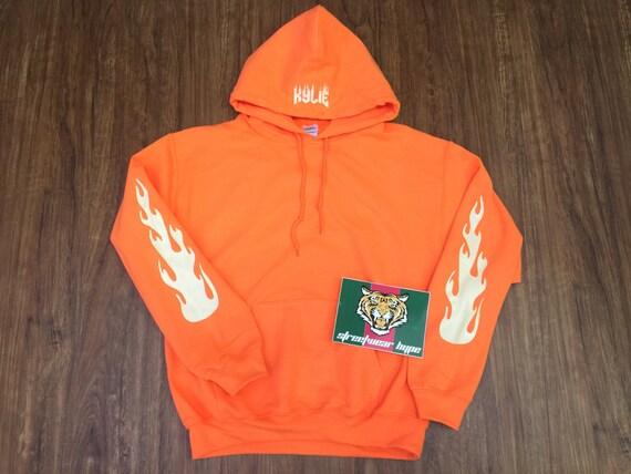 kylie jenner hoodie orange the kylie pop up shop merchthe. Black Bedroom Furniture Sets. Home Design Ideas