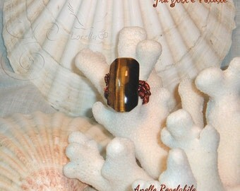 Copper ring with Tiger's eye cabochons.