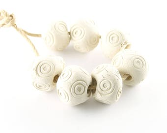 Blank clay beads rough white porcelain round beads with swirl print 14 mm across set of 7 beads ErikMakesBeads