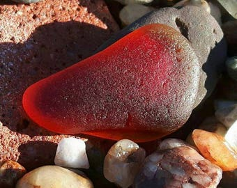 Stunning piece of flawless red sea glass with an orange tint jewelery quality surf tumbled genuine sea glass