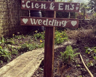 Rustic hand painted personalised wooden wedding/name signs.