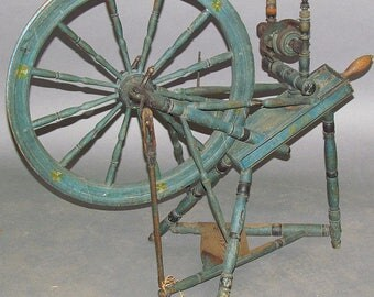 Antique Spinning Wheel in old blue paint